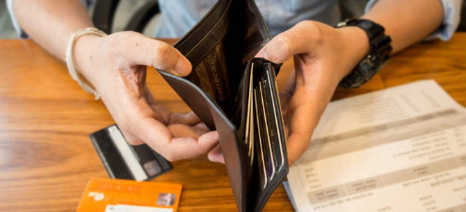 Hands holding open a wallet