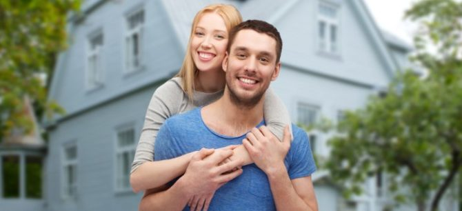 Florida couple standing outside their home that is not carrying enough homeowners insurance